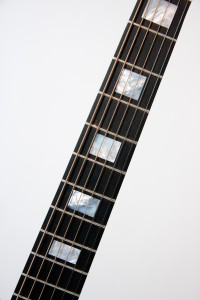 Fingerboard - Ebony and mother of pearl inlay